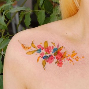 Watercolor tattoo by 9room #9room #watercolor #color #unique #nature #floral #flowers #shoulder