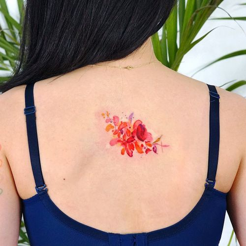 Watercolor tattoo by 9room #9room #watercolor #color #unique #nature #rose #floral #flower #backtattoo