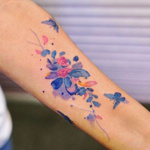 Watercolor tattoo by 9room #9room #watercolor #color #unique #nature #flower #florals