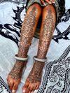 Pattern work tattoo by Swasthik Iyengar aka Gunga Ma #SwasthikIyengar  #GungaMa #color #traditional #Hindu #sacredsymbols #sacrediconography #pattern #folkart #linework #dotwork #floral #foot #shin