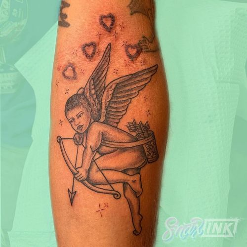 Tattoo by Debbi Snax #DebbiSnax #illustrative #angel #cherub #wings #hearts #bowandarrow #sparkle #tattoosondarkskin