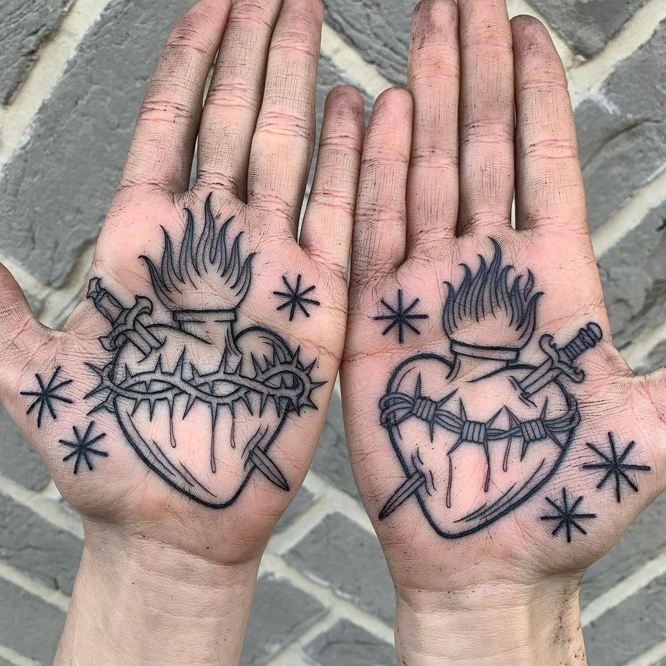 sacred heart palm tattoos by Luke A Ashley #LukeAAshley #palmtattoo #sacredheart #palm #hand #heart #fire #dagger #thorns #barbedwire