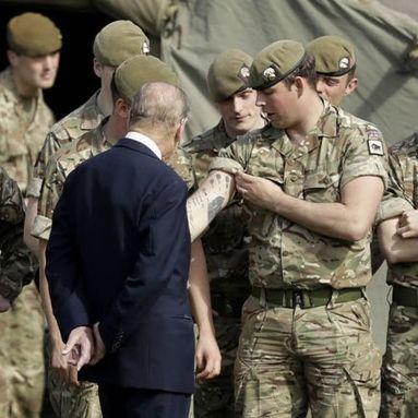 Prince Philip, Duke of Edinburgh admiring the tattoos of a soldier in Aldershot #tattooedroyals #militarytattoos #historyoftattooing