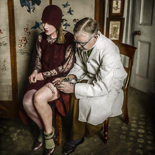 George Burchett tattooing the upper leg of a female client #historictattoos #vintagetattoos #kingoftattooists