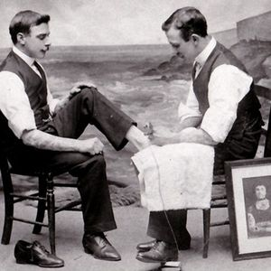 George tattooing his younger brother Charles, a fellow tattooist who never achieved the same acclaim – image courtesy of the Tattoo Archive #georgeburchett #charlesburchett #electrictattoomachine #historictattoos