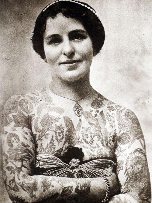 Edith Burchett showcasing tattoos done by her husband George #GeorgeBurchett #EdithBurchett #historictattoos #twentiethcenturytattoos #vintagetattoos #thekingoftattooists