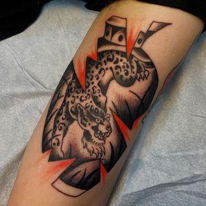 Tattoo by Sema Dayoub #semadayoub #nassimdayoub #traditionaltattoo #qttr #queertattooer #leopard #vase #junglecat #cat