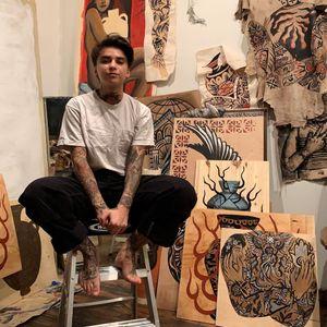 Portrait of Sema Dayoub with their artwork #semadayoub #nassimdayoub #traditionaltattoo #qttr #queertattooer