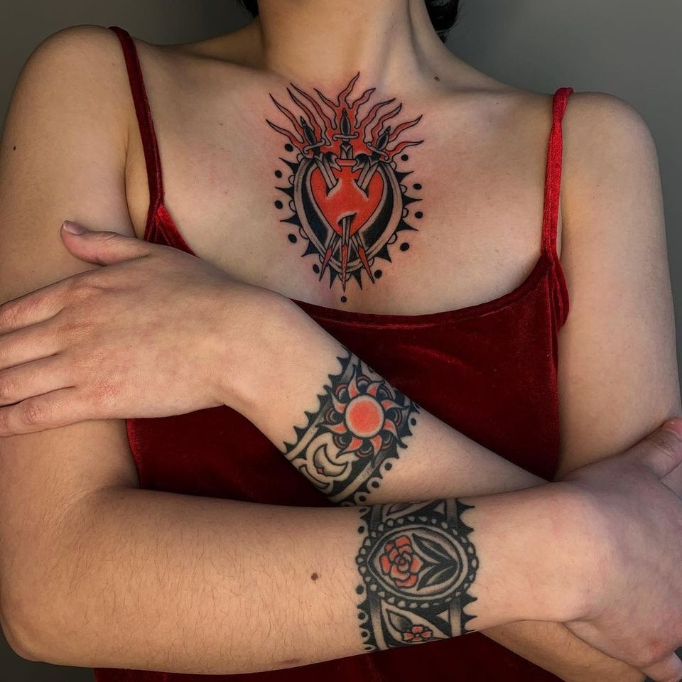Tattoos by Sema Dayoub #semadayoub #nassimdayoub #traditionaltattoo #qttr #queertattooer #cuffs #bracelet #flower #sun #heart #sacredheart #threeofswords #chest #wrist