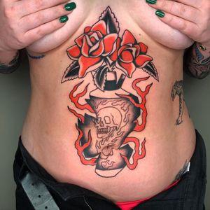 Tattoo by Sema Dayoub #semadayoub #nassimdayoub #traditionaltattoo #qttr #queertattooer #stomach #vase #fire #rose #skull