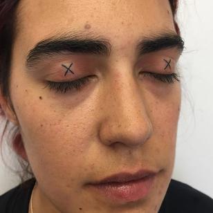 Eyelid tattoo by lndy Voet #IndyVoet #eyelidtattoo #eyelid #linework #facetattoo #face
