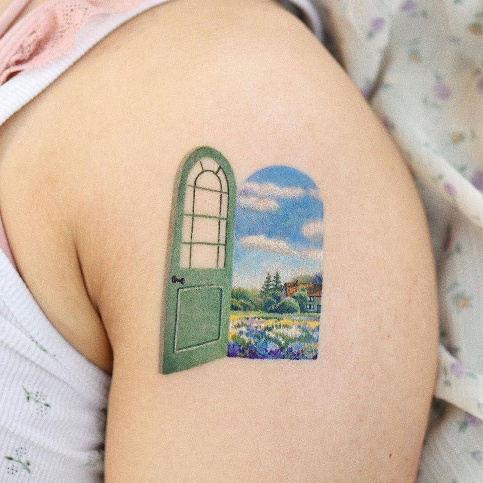 Landscape arm tattoo by saegeem #saegeem #landscapetattoo #landscape #nature #watercolor #arm #clouds #flowers #door #cottage