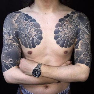 Excellent black and grey half sleeves by Horitada (IG—horitadajapan). #blackandgrey #Horitada #Irezumi #koi #sleeves #traditional