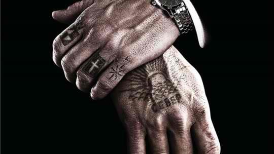 Classy finger tattoo, artist unknown.