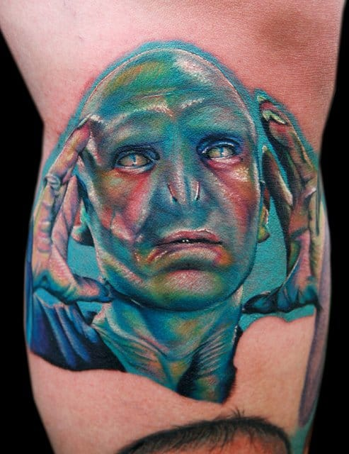 Spooky Voldemort tattoo by Cecil Porter. Also a great example for the collectors of Harry Potter tattoos. #voldemort #HarryPotter #fantattoo #tribute #portrait #colorrealism