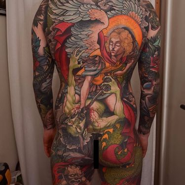 Michael Vanquishes Lucifer in a Large-Scale Tattoo by Peter Lagergren