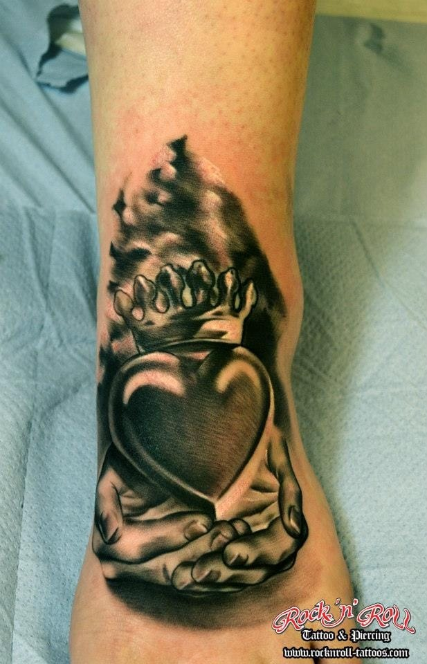 Realistic black and grey piece by Rafael at Rock'n'Roll Tattoo.