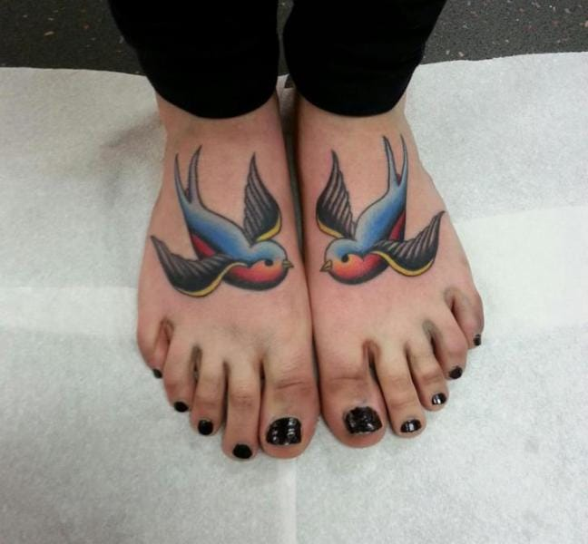 Colourful swallow tattoos by Alan's Tattoo Studio #swallow #swallows #bird #foot #matching