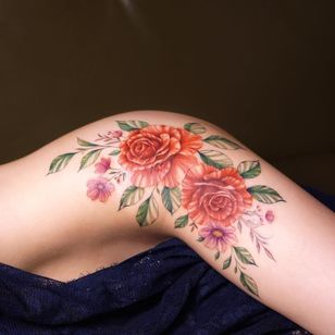 Roses tattoo by Tattooist Silo #TattooistSilo #Silo #flowertattoos #flowers #roses #daisies #leaves #nature #floral #plant #color #watercolor #realistic #illustrative #tattoooftheday
