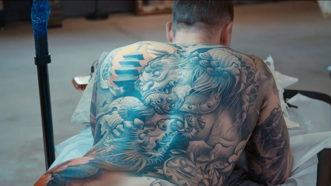 Bodysuit in progress by Christopher Henriksen #residentartists #thetattooshop #miami #wynwood #tvseries #facebookwatch #bodysuit #dragon #protector #guardian #deity #fudog #foodog #blackandgrey #pagoda #Japanese #NeoJapanese