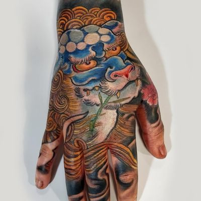 Shishi tattoo by Alessandro Pellegrini #AlessandroPellegrini #handtattoos #color #Japanese #Shishi #lion #Chinese #guardian #foodog #protector #leaves #peony #pattern