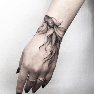 Hand tattoo by Vlada Shevchenko #VladaShevchenko #handtattoos #blackandgrey #realism #realistic #betafish #fish #scales #oceanlife #tropical