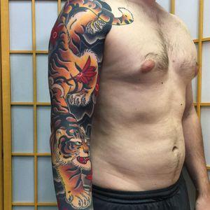 Tattoo by Sergey Buslay #SergeyBuslay #tattoodoambassador #Japanese #irezumi #waves #smoke #mapleleaves #leaves #nature #tiger #fall #cat #junglecat