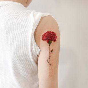 Birth month flower tattoo by Dahong Tattoo #DahongTattoo #Carnation #carnationtattoo #birthmonthflowertattoos #birthmonthflowers #flowertattoo #flowers #florals #petals #blooms #leaves #nature #plant #birthmonth