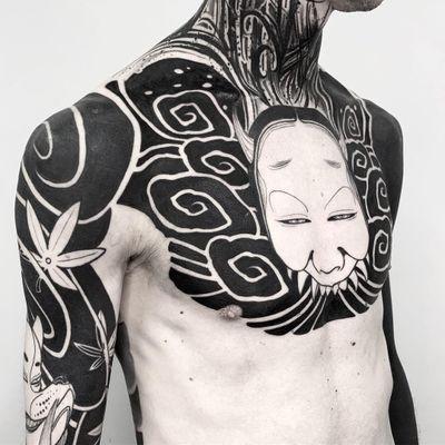 Chest and sleeve tattoos by Oscar Hove #OscarHove #torsotattoos #torso #bigtattoo #bigtattoos #bodysuit #blackwork #illustrative #mask #leaves #japanese #neojapanese #hannya #kitsune #clouds #darkart