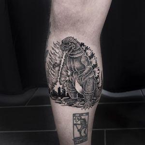 Godzilla tattoo by Mike End #MikeEnd #lowerleg #godzilla - Top 10 Cities to Get Tattooed In #Paris #tattooidea #tattoo #tattooart #vacation #travel #top10 #top10cities #gettattooed