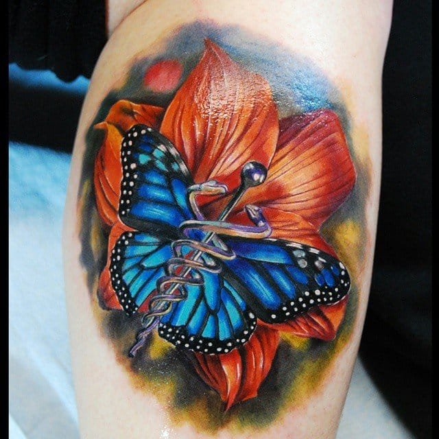 Lovely flower and butterfly as a background for a medical caduceus tattoo by Justin Buduo.