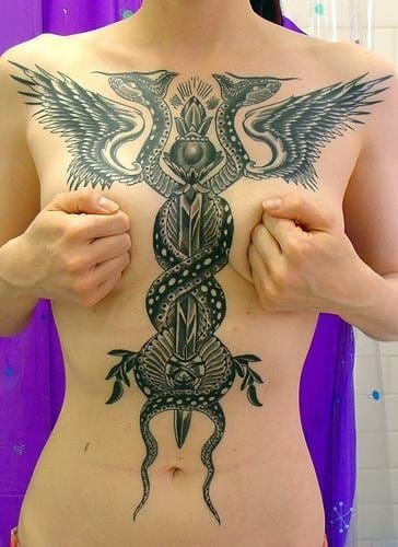 A cool torso tattoo! Could you credit the artist please?