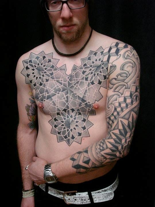 Dotwork tattoo on chest by Cory Ferguson. #dotwork #chestpiece #geometric #geometry