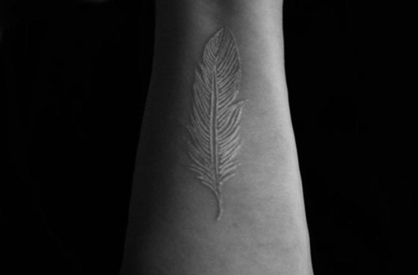 Feathers are great in white. Beautiful feather white ink tattoos #whiteink #whiteinktattoo #feather #linework #simple