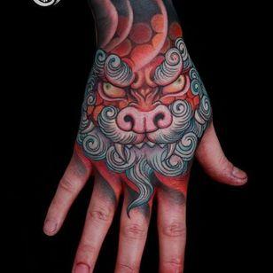 Epic Hand Tattoo by Yushi Tattoo