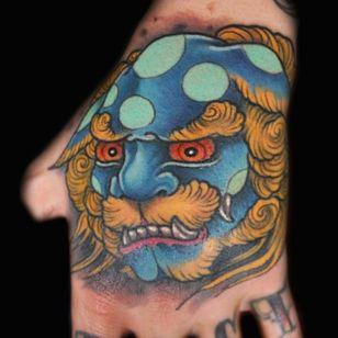 Bright Hand Tattoo by Matt Hart