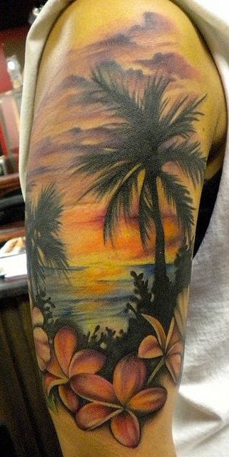 Sunset at the beach is the classic idea of a good summer and a popular tattoo. Here by Amanda Leadman.