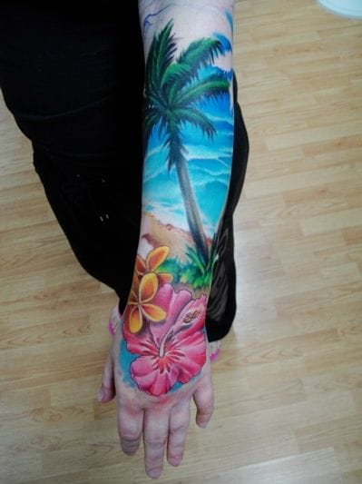 Great colors on this sleeve and hand tattoo by Sean Duffy.