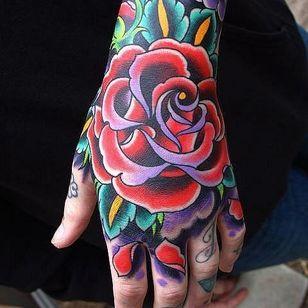 Beautiful color blasted hand tattoo.