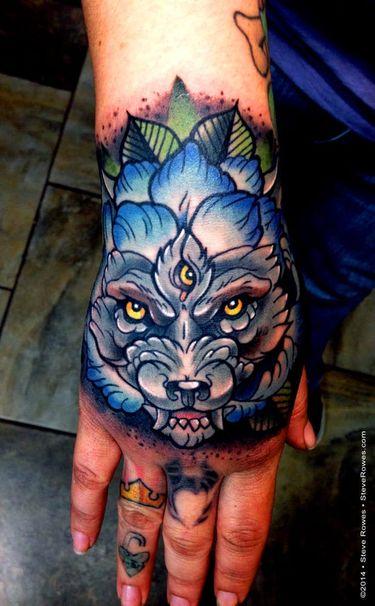 8 Wonderful Wolf Hand Tattoos