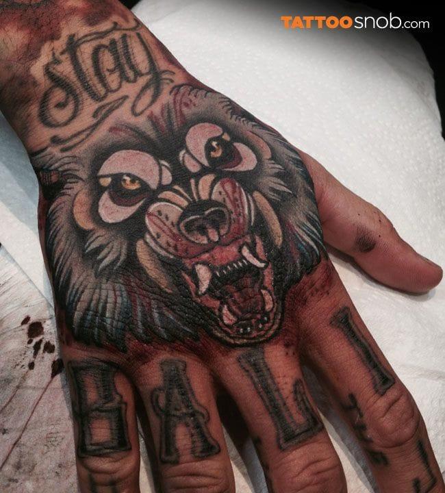 Great wolf hand tattoo by Heath Clifford