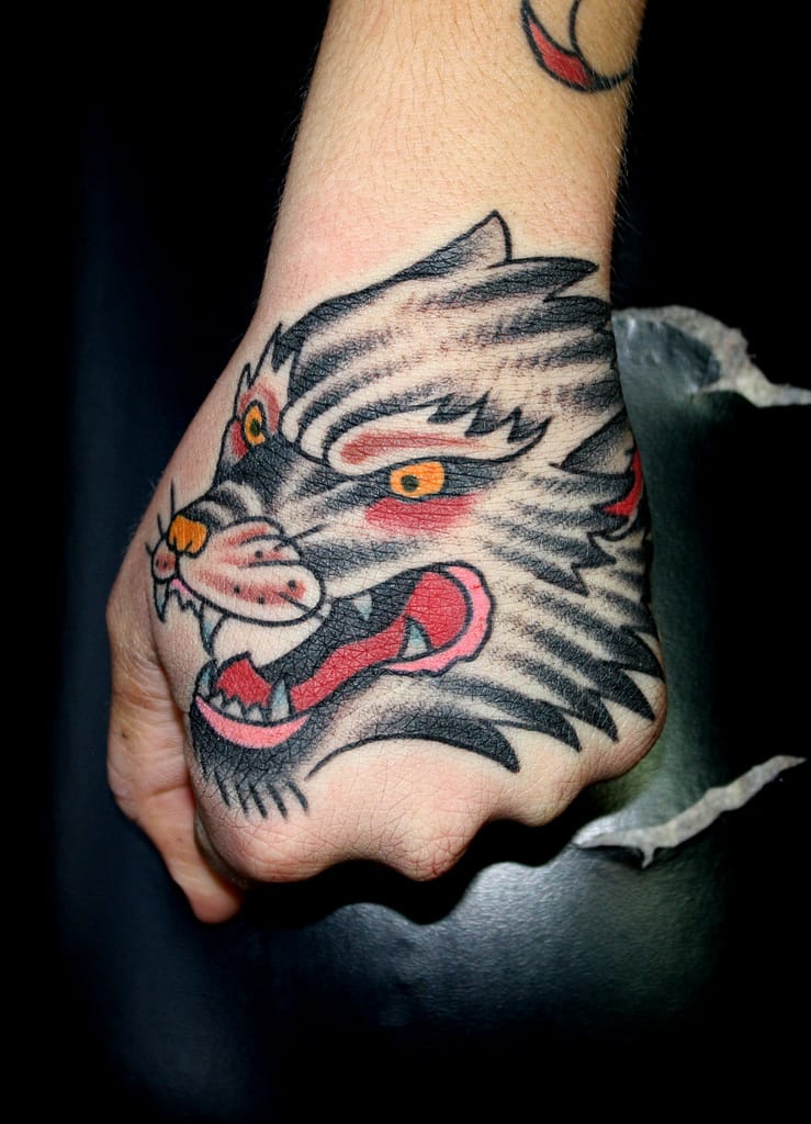 Wold hand tattoo by Myke Chambers