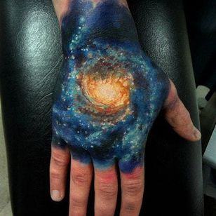 I have my very own galaxy on my hand, he says... Tattoo by Insane.