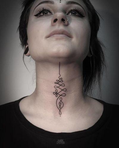 Elegant throat tattoo by Mark Ostein. #unalome #spiritual #symbol #linework