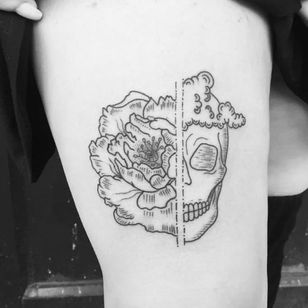 Skull and peony tattoo by Lilly Anchor, DareDevil Tattoo, NYC (Instagram @lillyanchor).