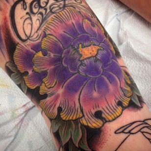 Purple knee tattoo by Seth Campbell, Massachusetts (Instagram @cloudcitytattoo).