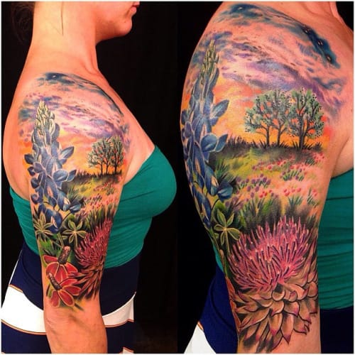 Love the sunny vibrant colors in this Landscape Tattoo by Mo Malone. I can almost smell the flowers!!!