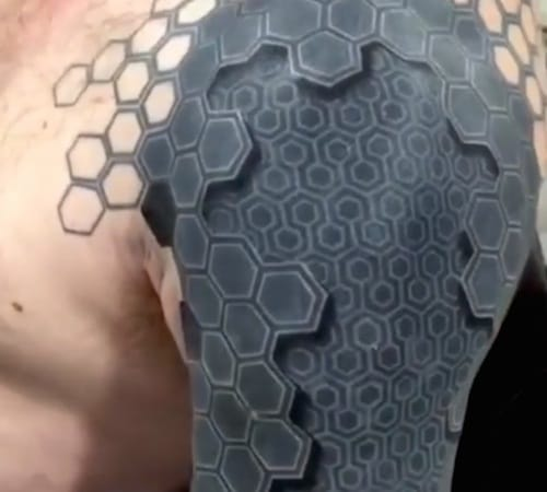 Amazing 3D effect on this hexagonal sleeve tattoo! It's all about composition & application! Artist unknown