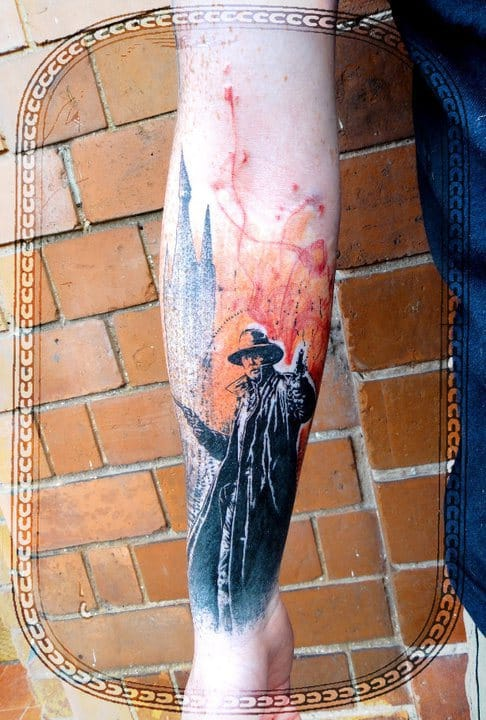 The graphic style of Xoil fits this Dark Tower tattoo.
