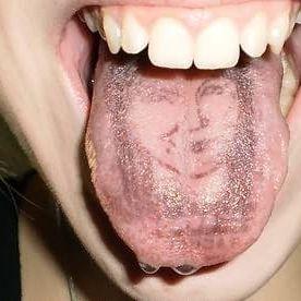 Tongue portrait tattoo